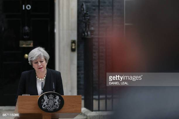 TOPSHOT Britain's Prime Minister Theresa May delivers a statement outside 10 Downing Street in central London on May 23 2017 after an emergency...
