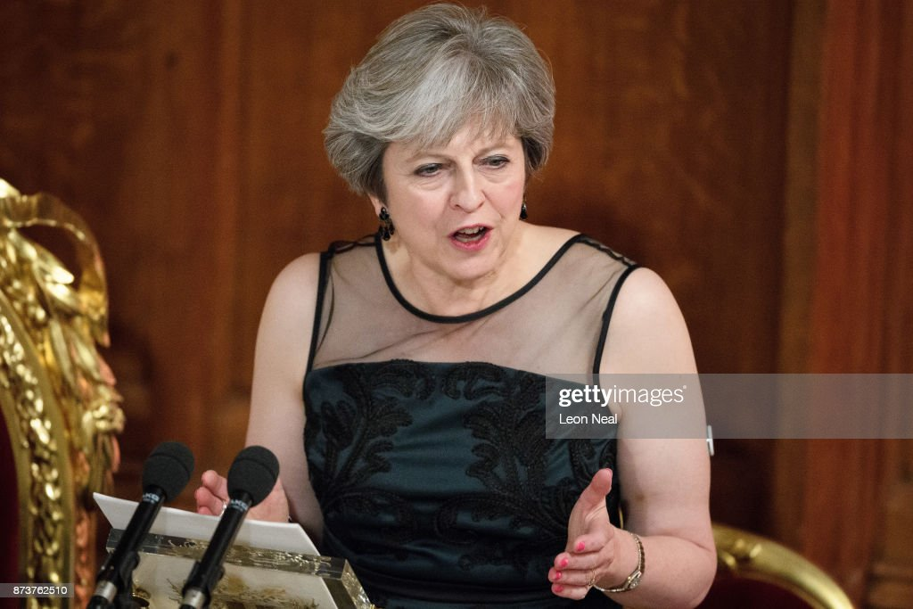 Britain's Prime Minister Theresa May delivers her speech at the annual Lord Mayor's banquet on November 13, 2017 in London, England. The Prime Minister spoke of various global issues, including Russia's involvement in destablising countries and elections around the world. The British Prime Minister Theresa May, long known to have Type 1 Diabetes, has been wearing a Nootrobox Continuous Glucouse Monitoring (CGM) patch on her upper arm to help with the control of the disease. The CGM device is implanted into the skin and sends data on glucose levels to a smart phone. Last night the implant was seen clearly on the Prime Minister's arm as she wore a sleeveless, green evening dress.