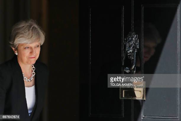 Britain's Prime Minister Theresa May exits the door of 10 Downing Street in London on June 19 to greet Ireland's Taoiseach Leo Varadkar ahead of...
