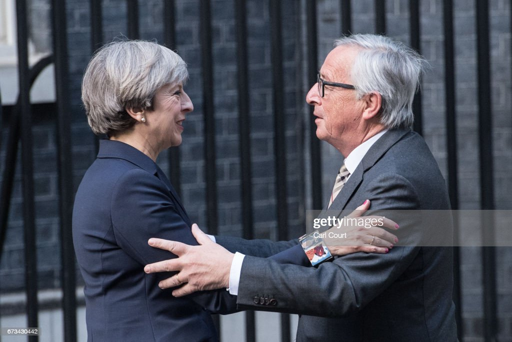 Britain's Prime Minister, Theresa May, greets European Commission president, Jean-Claude Juncker, as he arrives at 10 Downing Street on April 26, 2017 in London, England. Prime Minister May is to hold her first major talks with E.U leaders since calling a general election in a bid to strengthen her position in forthcoming Brexit negotiations.