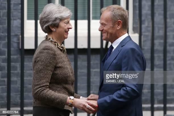 Britain's Prime Minister Theresa May greets European Council president Donald Tusk on his arrival for a meeting at 10 Downing Street in central...