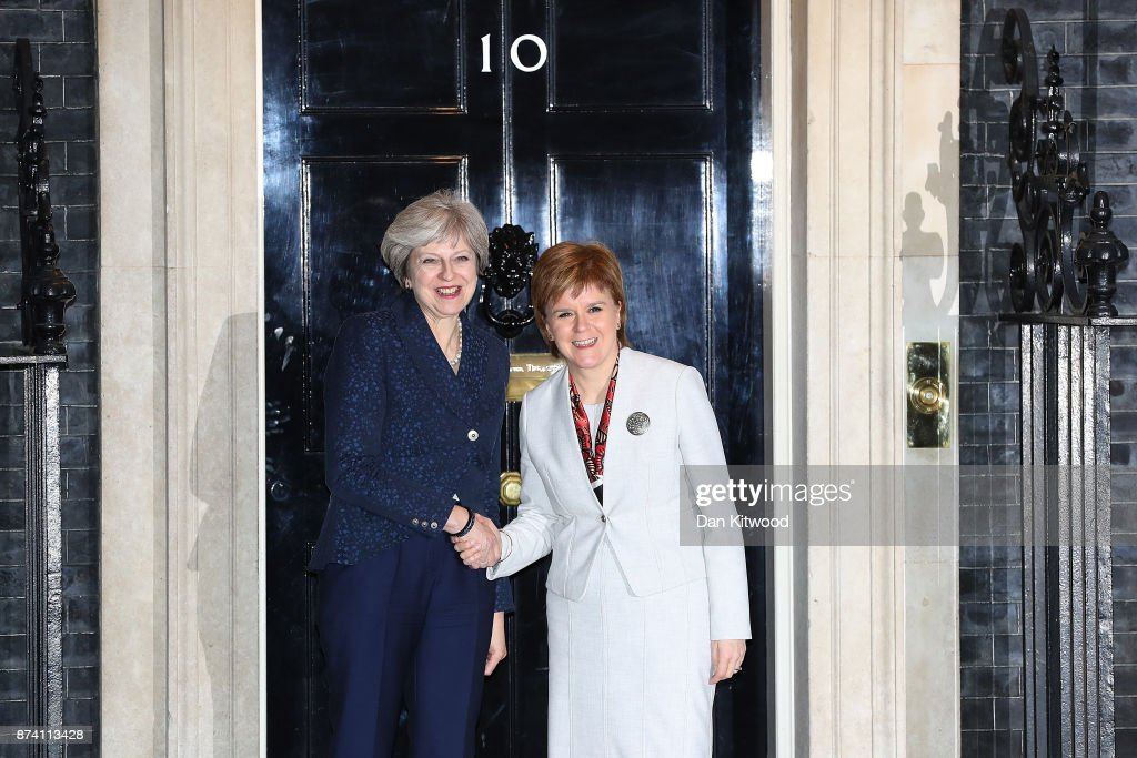 Britain's Prime Minister Theresa May (L) greets First Minister and Scottish National Party Leader Nicola Sturgeon to 10 Downing Street on November 14, 2017 in London, England. The SNP leader is visiting Downing Street for her first face-to-face talks with the Prime Minister since March.