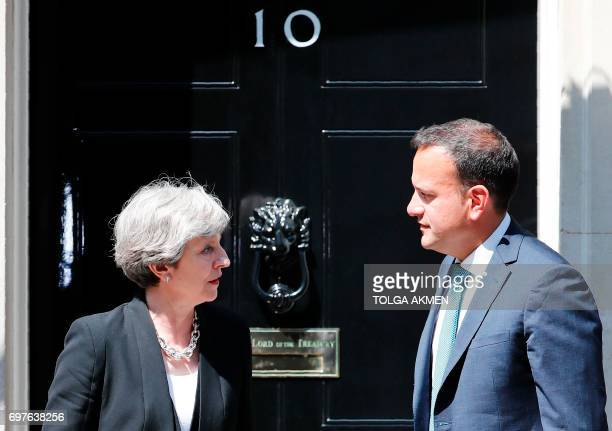 Britain's Prime Minister Theresa May greets Ireland's Taoiseach Leo Varadkar before their meeting outside 10 Downing Street in London on June 19 2017...