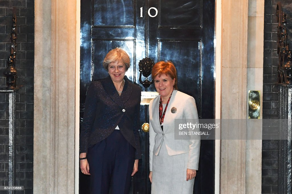 Britain's Prime Minister Theresa May (L) greets Scotland's First Minister Nicola Sturgeon at 10 Downing Street in central London on November 14, 2017. / AFP PHOTO / Ben STANSALL