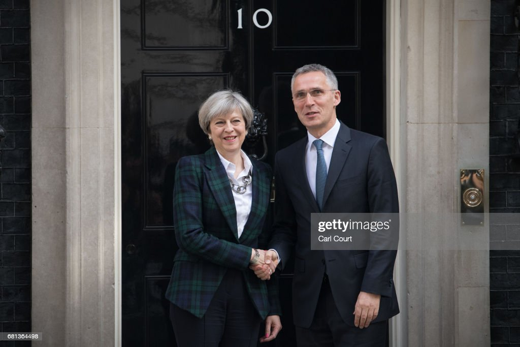 Britain's Prime Minister, Theresa May (L), greets Secretary General of NATO, Jens Stoltenberg, upon his arrival in Downing Street on May 10, 2017 in London, England. NATO has reportedly asked Britain to consider sending more troops to Afghanistan.