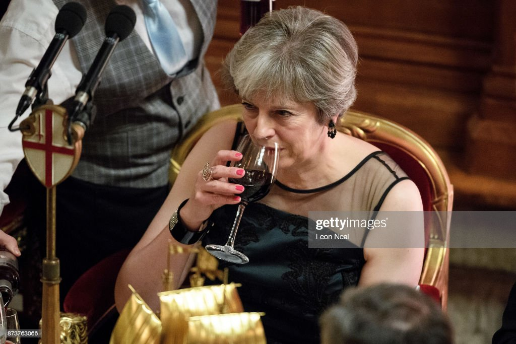 Britain's Prime Minister Theresa May has a drink after delivering her speech at the annual Lord Mayor's banquet on November 13, 2017 in London, England. The Prime Minister spoke of various global issues, including Russia's involvement in destablising countries and elections around the world.