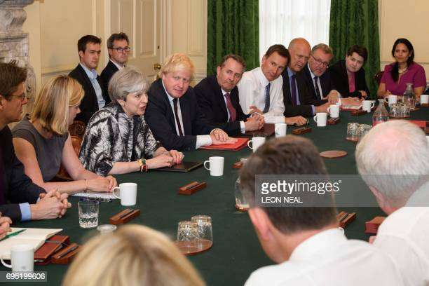 Britain's Prime Minister Theresa May holds the first Cabinet meeting of her new team Britain's Business Energy and Industrial Strategy Secretary Greg...