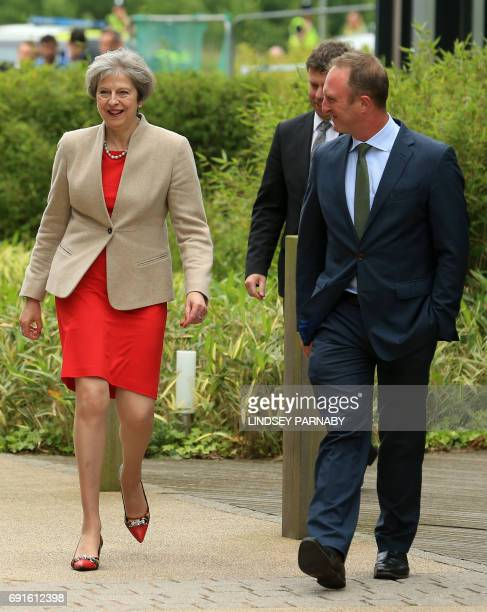 Britain's Prime Minister Theresa May is accompanied by head of BBC News James Harding on her arrival for the BBC One Question Time Leaders Special to...