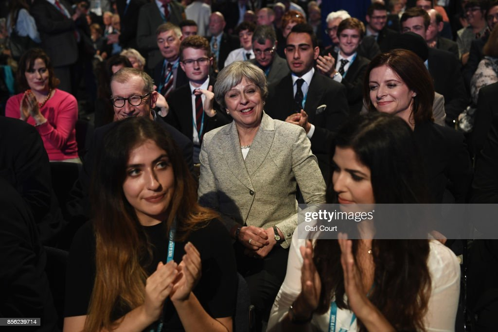 Britain's Prime Minister Theresa May is applauded as she attends the first day of the annual Conservative Party conference on October 1, 2017 in Manchester, England. Theresa May has targeted young voters pledging help on student fees and housing as the Conservatives gather in Manchester for their annual party conference, amid reports of growing Cabinet divisions over the Brexit strategy.