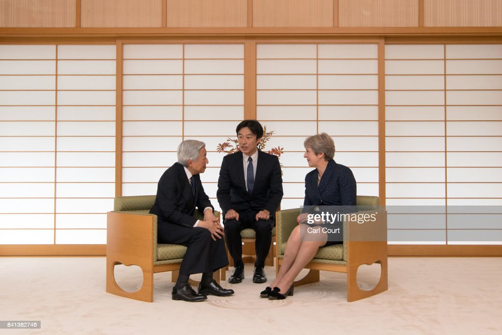 Britain's Prime Minister, Theresa May (R), is greeted by Emperor Akihito of Japan during her visit to the Royal Palace on September 1, 2017 in Tokyo, Japan. Mrs May is on the third and final day of her visit to Japan where she has discussed a number of issues including trade and security.