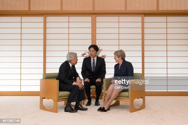 Britain's Prime Minister Theresa May is greeted by Emperor Akihito of Japan during her visit to the Royal Palace on September 1 2017 in Tokyo Japan...