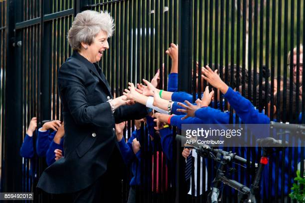 Britain's Prime Minister Theresa May is greeted by pupils during her visit to Dunraven School in South London The Prime Minister visited the school...