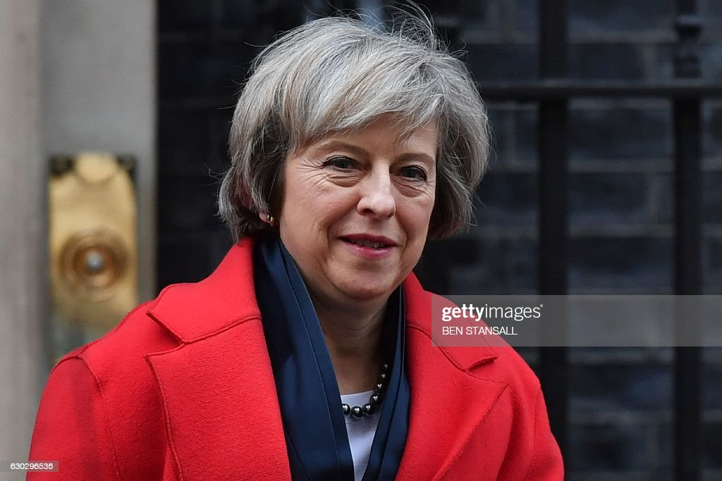 Britain's Prime Minister Theresa May leaves 10 Downing Street in London on December 20, 2016 ahead of an evidence session with the Commons Liason Committee at the House of Commons. The prime minister was set to appear before the parliamentary committee to be questioned on Brexit. / AFP / BEN