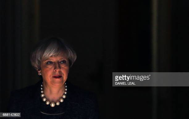 TOPSHOT Britain's Prime Minister Theresa May leaves 10 Downing Street in central London on May 25 2017 Britain's Prime Minister Theresa May said...