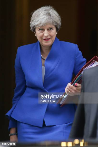 Britain's Prime Minister Theresa May leaves 10 Downing Street in central London on July 19 on her way to the Houses of Parliament to speak at Prime...
