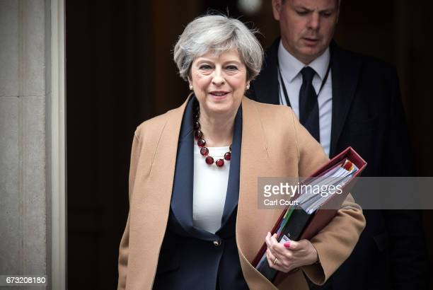 Britain's Prime Minister Theresa May leaves 10 Downing Street to attend Prime Minister's Questions in Parliament on April 26 2017 in London England...