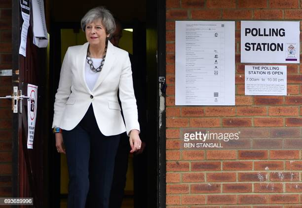 Britain's Prime Minister Theresa May leaves a polling station after casting her ballot paper in Sonning west of London on June 8 as Britain holds a...