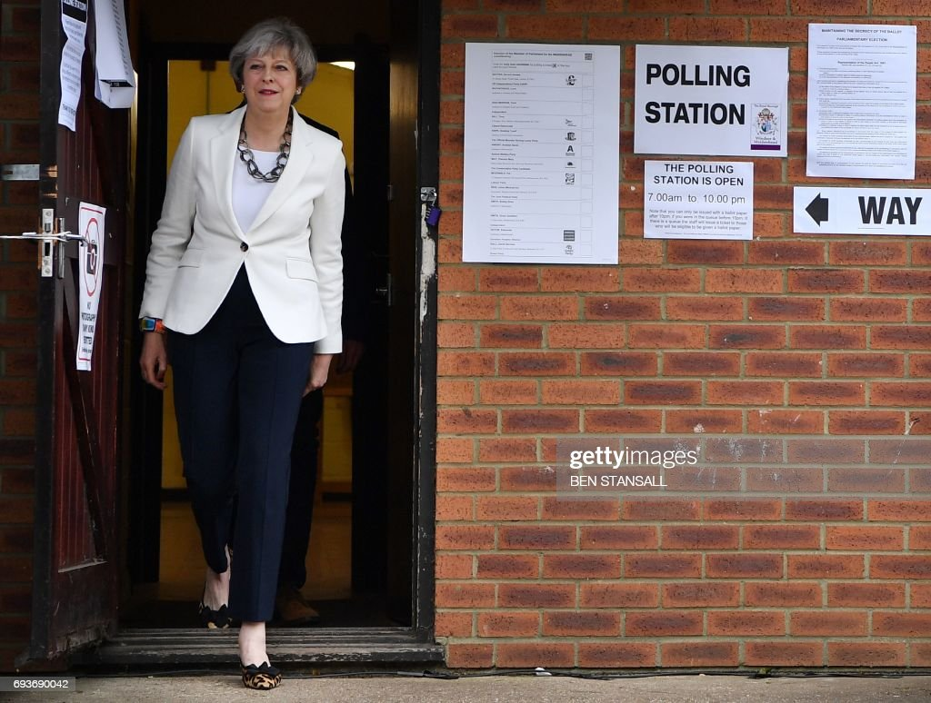 Britain's Prime Minister Theresa May leaves a polling station after casting her ballot paper in Sonning, west of London, on June 8, 2017, as Britain holds a general election. As polling stations across Britain open on Thursday, opinion polls show the outcome of the general election could be a lot tighter than had been predicted when Prime Minister Theresa May announced the vote six weeks ago. /
