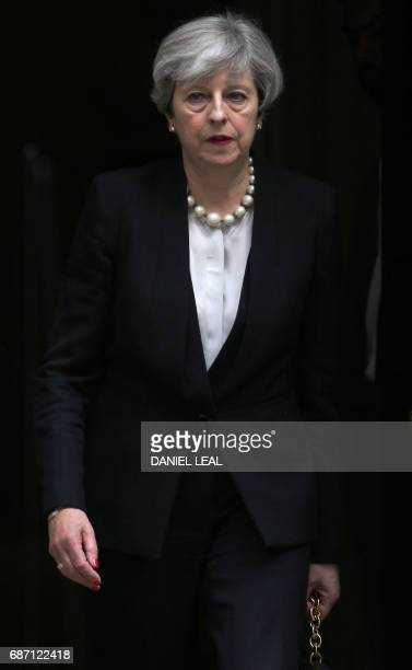 Britain's Prime Minister Theresa May leaves after delivering a statement at 10 Downing Street in central London on May 23 2017 after an emergency...