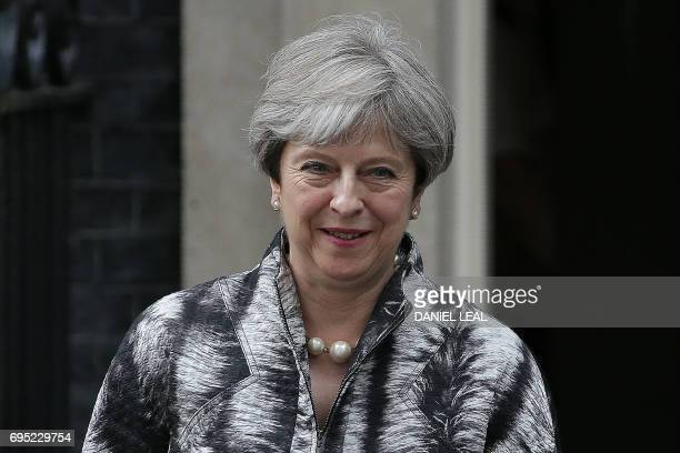 Britain's Prime Minister Theresa May leaves after hosting a Cabinet meeting at 10 Downing Street in central London on June 12 following the June 8...