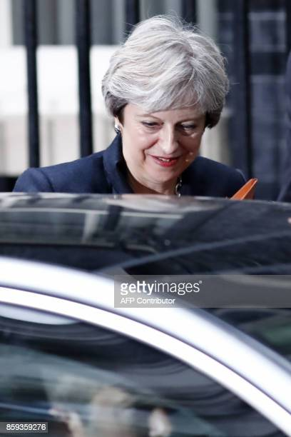 Britain's Prime Minister Theresa May leaves for the House of Commons from 10 Downing Street in central London on October 9 2017 British Prime...