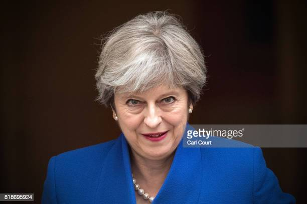 Britain's Prime Minister Theresa May leaves for the weekly Prime Minister's Questions at the House of Commons on July 19 2017 in London England This...