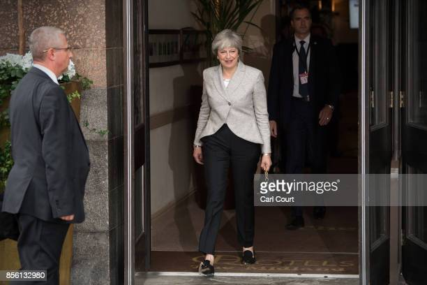 Britain's Prime Minister Theresa May leaves her hotel to attend a television interview on the first day of the annual Conservative Party conference...