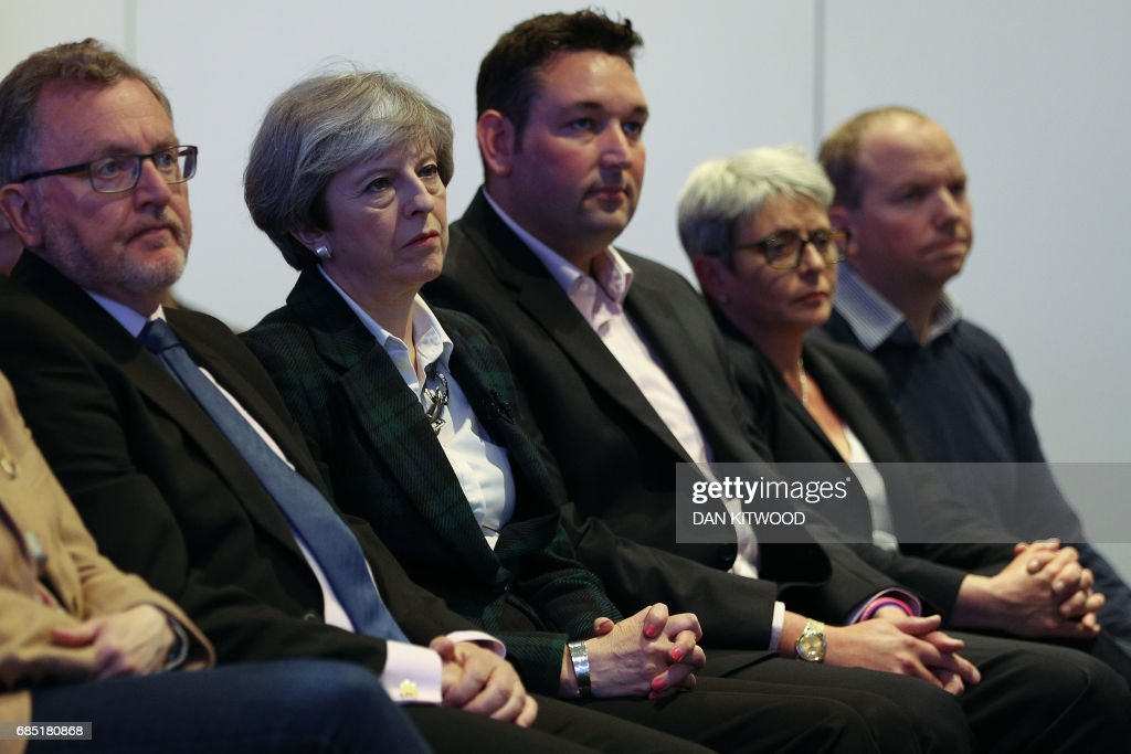 Britain's Prime Minister Theresa May (2L) listens as Scottish Conservative leader Ruth Davidson speaks during the launch of their Scottish manifesto in Edinburgh on May 19, 2017. / AFP PHOTO / POOL / Dan Kitwood