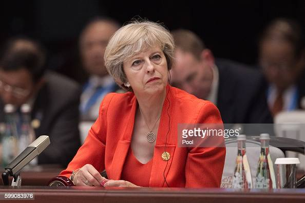 Britain's Prime Minister Theresa May listens to Chinese President Xi Jinping speech during the opening ceremony of the G20 Leaders Summit on...