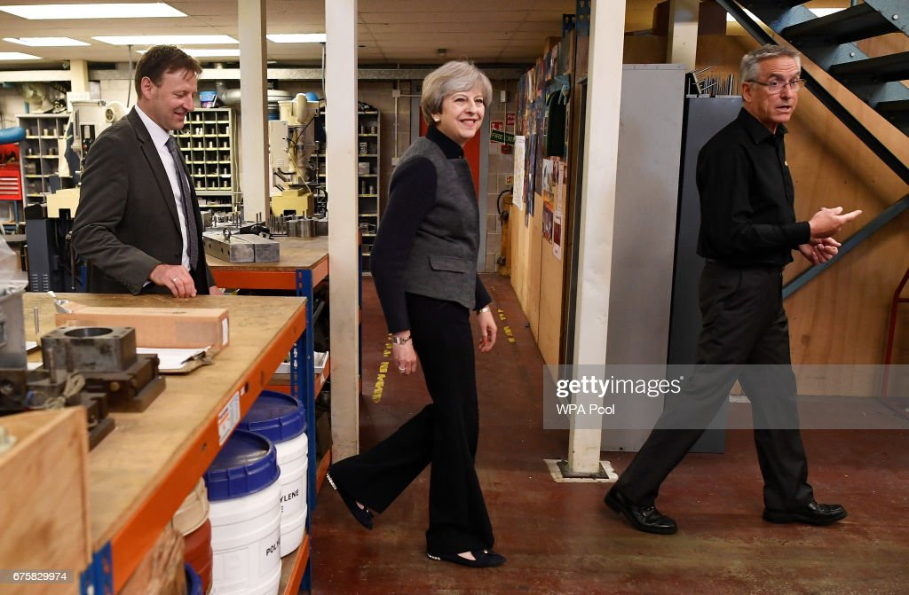 Britain's Prime Minister Theresa May makes a campaign stop at a company on May 2, 2017 in St Yves, Cornwall, England. The Prime Minister is campaigning in South-West England, a former Liberal Democrat stronghold, as she urges West Country voters to stick with her party ahead of the polls on June 8.