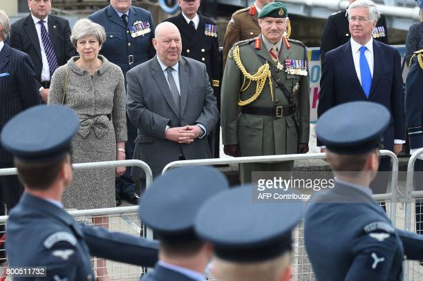 Britain's Prime Minister Theresa May Mayor of Liverpool Joe Anderson Vice Chief of Defence Staff General Gordon Messenger and Britain's Defence...