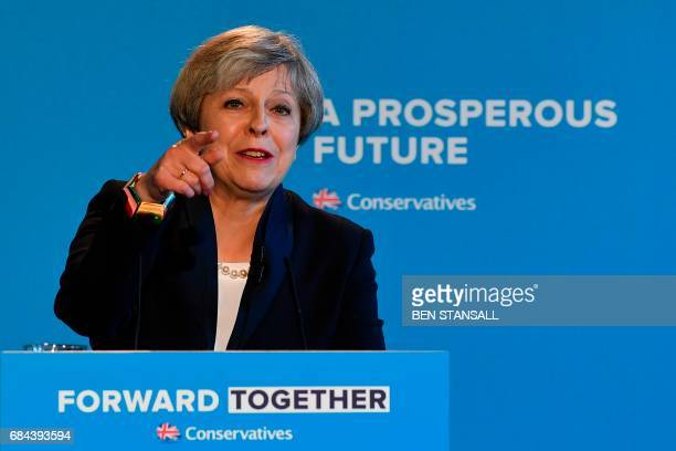 Britain's Prime Minister Theresa May points as she takes questions during an event to launch the Conservative Party general election manifesto in...