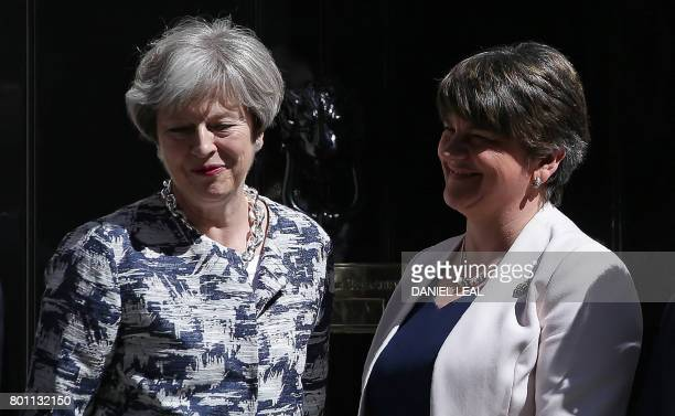 Britain's Prime Minister Theresa May poses for a picture with Democratic Unionist Party leader Arlene Foster at 10 Downing Street in central London...