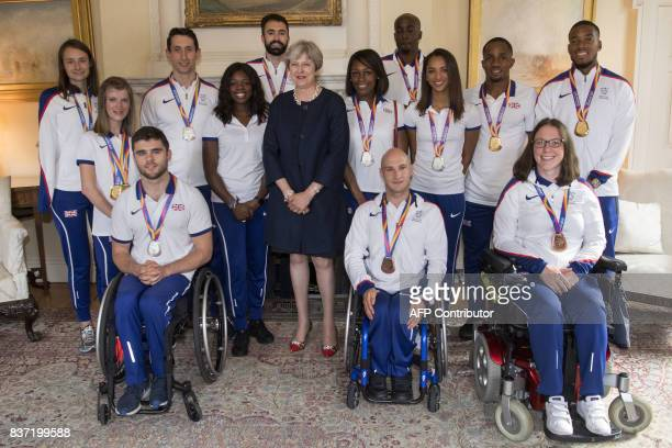 Britain's Prime Minister Theresa May poses with athletes during a reception for British athletes who competed in the World Athletics Championships...