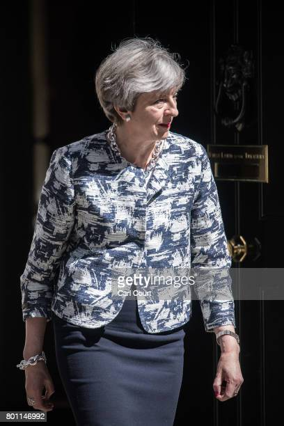 Britain's Prime Minister Theresa May prepares to greet Arlene Foster the leader of Northern Ireland's Democratic Unionist Party deputy leader of the...