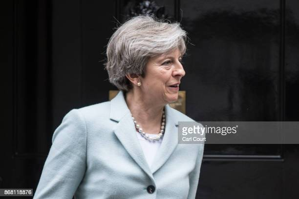 Britain's Prime Minister Theresa May prepares to greet Carwyn Jones the First Minister of Wales as he arrives in Downing Street on October 30 2017 in...