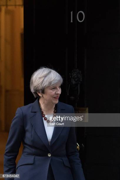 Britain's Prime Minister Theresa May prepares to greet European Commission president JeanClaude Juncker on April 26 2017 in Downing Street London...