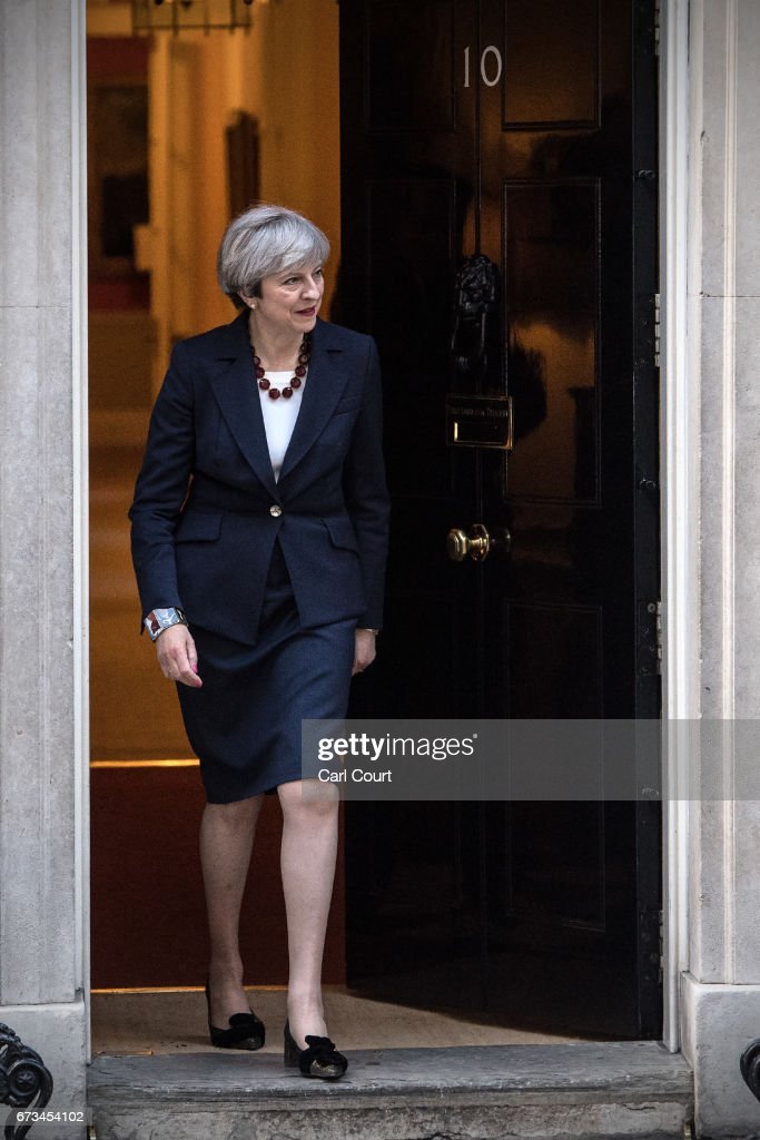 Britain's Prime Minister, Theresa May, prepares to greet European Commission president, Jean-Claude Juncker, on April 26, 2017 in Downing Street, London, England. Prime Minister May is to hold her first major talks with E.U leaders since calling a general election in a bid to strengthen her position in forthcoming Brexit negotiations.