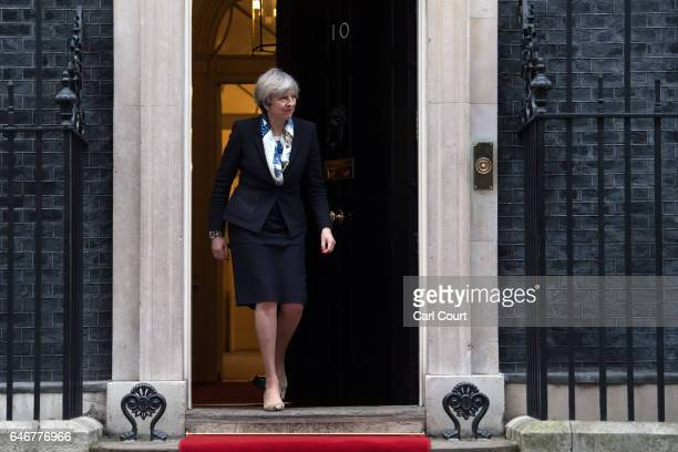 Britain's Prime Minister Theresa May prepares to greet King Abdullah II of Jordan as he arrives in Downing Street on March 1 2017 in London England...