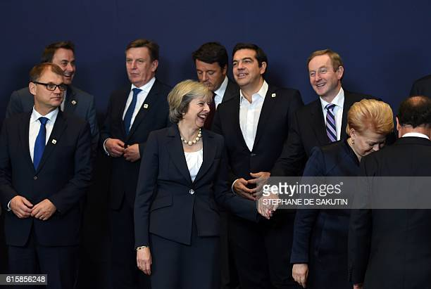 Britain's Prime minister Theresa May reacts with European leaders prior to a family picture during an European Union leaders summit on October 20...