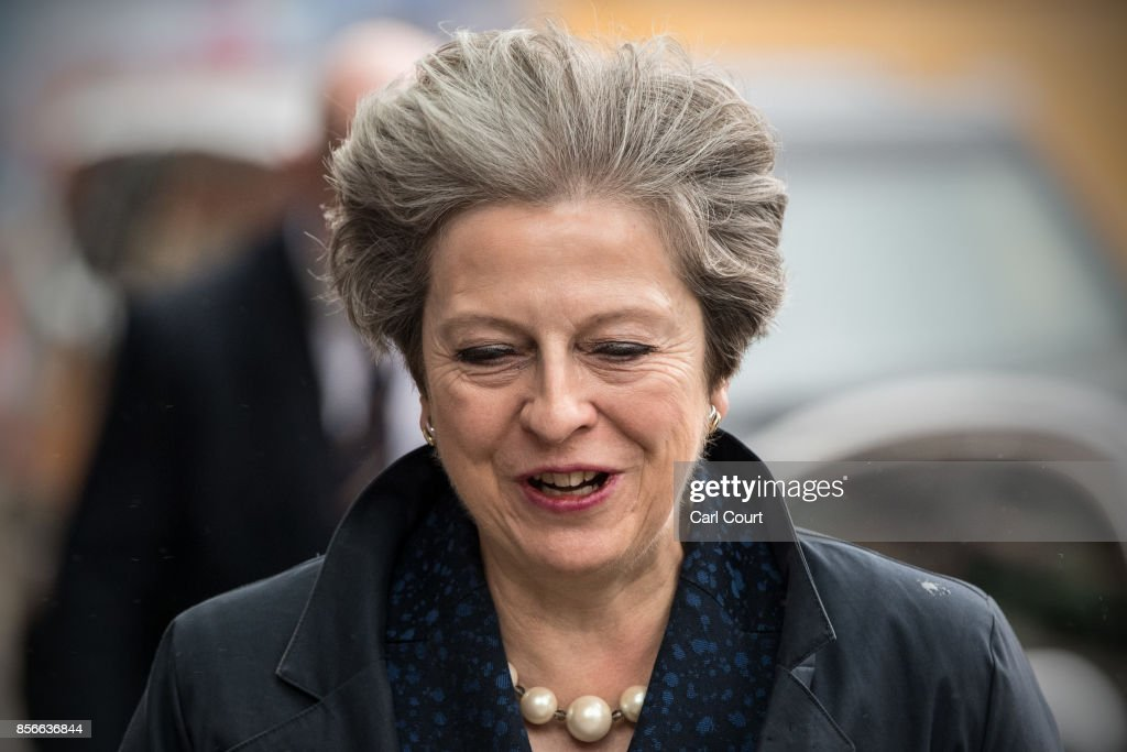 Britain's Prime Minister, Theresa May, returns to her hotel on day two of the Conservative Party Conference at Manchester Central on October 2, 2017 in Manchester, England. Chancellor Philip Hammond announced an extra GBP 300m to improve rail land transport links in northern England as part of the Northern Powerhouse initiative.