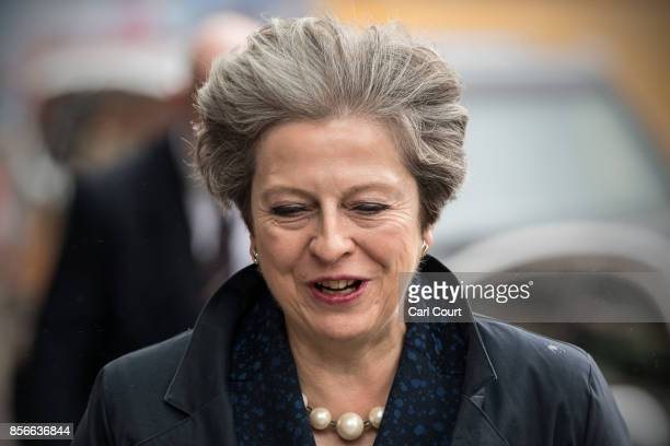 Britain's Prime Minister Theresa May returns to her hotel on day two of the Conservative Party Conference at Manchester Central on October 2 2017 in...