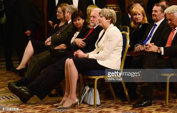 Britain's Prime Minister Theresa May sits next to the leader of Britain's opposition Labour Party Jeremy Corbyn ahead of a speech from Spain's King...
