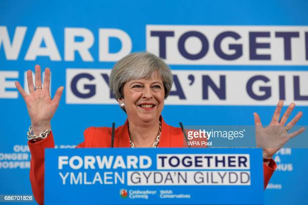 Britain's Prime Minister Theresa May speaks at an election campaign event on May 22 2017 in Wrexham Wales United Kingdom Theresa May has proposed...
