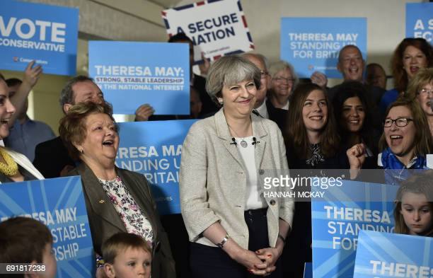 Britain's Prime Minister Theresa May speaks during a campaign event at Thornhill Cricket and Bowling Club in Dewsbury West Yorkshire on June 3 ahead...