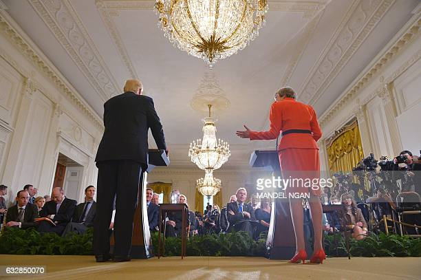 Britain's Prime Minister Theresa May speaks during a joint press conference with US President Donald Trump in the East Room of the White House on...
