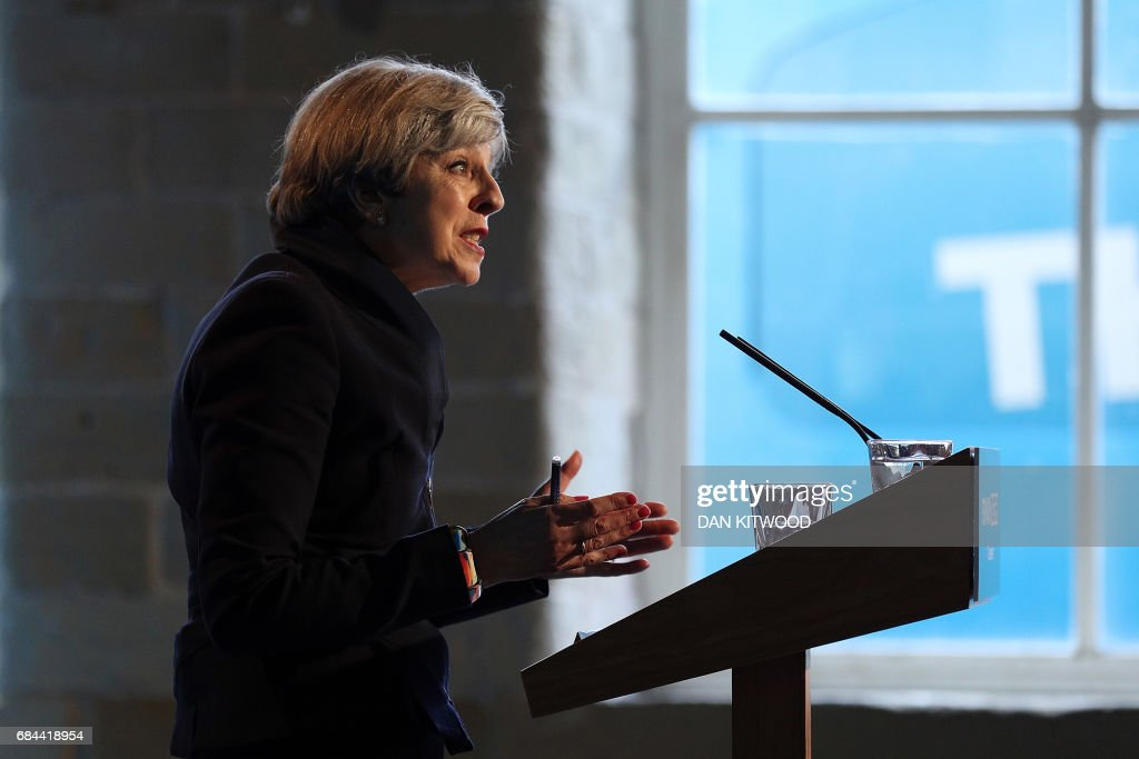 Britain's Prime Minister Theresa May speaks during an event to launch the Conservative Party general election manifesto in Halifax in northern England on May 18, 2017. British Prime Minister Theresa May will on May 18 promise to crack down on immigration from outside the European Union as she unveils the Conservative Party's manifesto. / AFP PHOTO / POOL / Dan Kitwood
