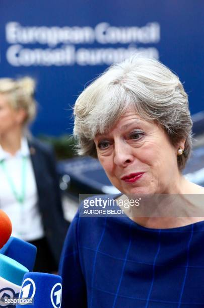 Britain's Prime minister Theresa May speaks to journalists as she arrives in Brussels on October 19 2017 on the first day of a summit of European...