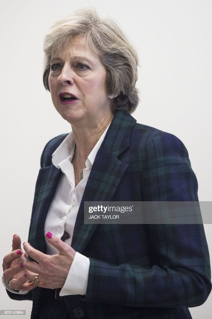 Britain's Prime Minister Theresa May speaks with charity Diabetes UK staff and volunteers during a visit to officially open their new office in London on November 14, 2016. May, who has been diagnosed with Type 1 diabetes, officially opened the new Diabetes UK office today to coincide with World Diabetes Day. / AFP / POOL / Jack Taylor