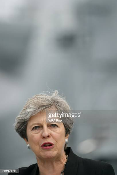 Britain's Prime Minister Theresa May stands on the flight deck and speaks to crew members of the 65000tonne British aircraft carrier HMS Queen...
